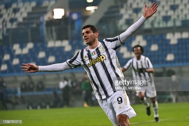 Juventus' Spanish forward Alvaro Morata celebrates after scoring during the Italian Super Cup football match between Juventus and Napoli on January...