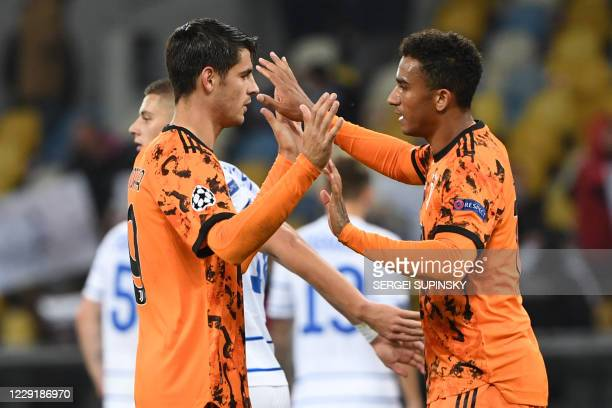Juventus' Spanish forward Alvaro Morata celebrates with a teammate after the UEFA Champions League group G football match between FC Dynamo Kiev and...