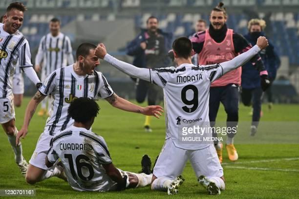 Juventus' Spanish forward Alvaro Morata celebrates with Juventus' Colombian midfielder Juan Cuadrado , Juventus' Italian defender Leonardo Bonucci...