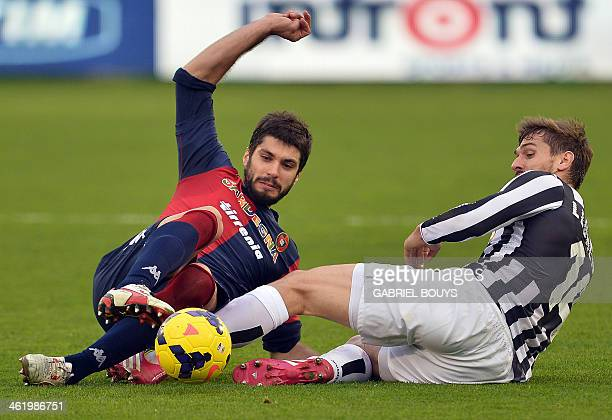 Juventus' Spanish forward Fernando Torres Llorente and Cagliari's defender Luca Rossettini fight for the ball during the Italian Serie A football...