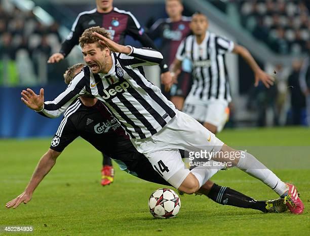 Juventus' Spanish forward Fernando Torres Llorente falls for a penalty during the UEFA Champions League Group B football match Juventus vs Copenhagen...