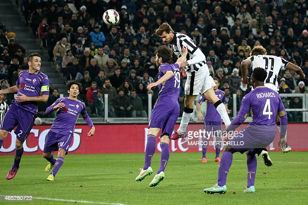 Juventus' Spanish forward Javier Fernando Torres Llorente heads the ball to score a goal during the Italian Tim cup football match Juventus Vs...