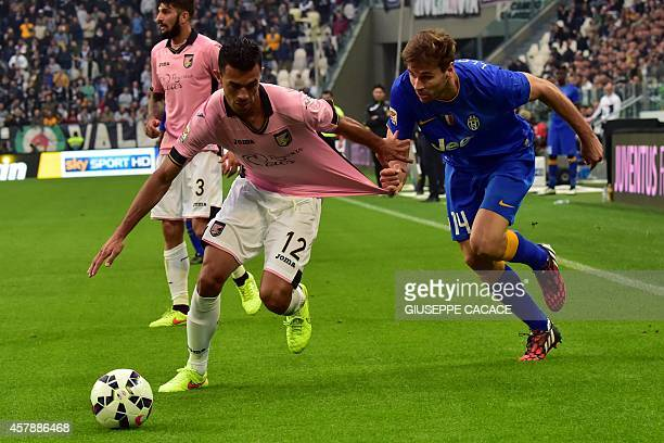Juventus Spanish foward Fernando Llorente fights for the ball with Palermo's defender Giancarlo Gonzalez during their Serie A match Juventus vs...