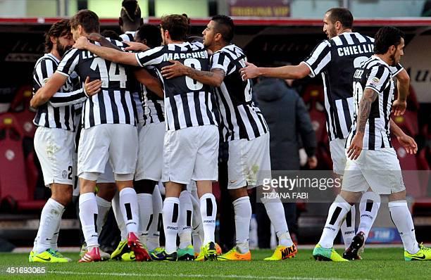 Juventus' Spanish foward Fernando Torres Llorente celebrates with teammates after scoring during the Serie A football match Livorno vs Juventus at...