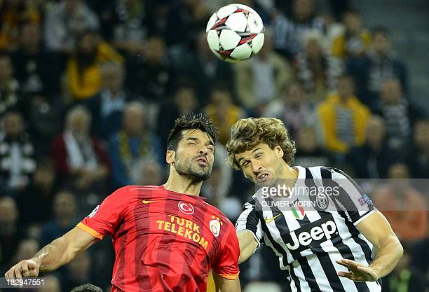 Juventus' Spanish foward Fernando Torres Llorente fights for the ball with Galatasaray's defender Gökhan Zan during the group B Champions League...