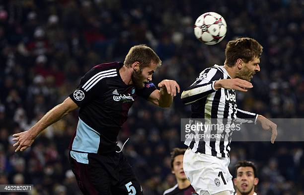 Juventus' Spanish foward Fernando Torres Llorente fights for the ball with FC Copenhagen's defender Olof Mellberg during the UEFA Champions League...