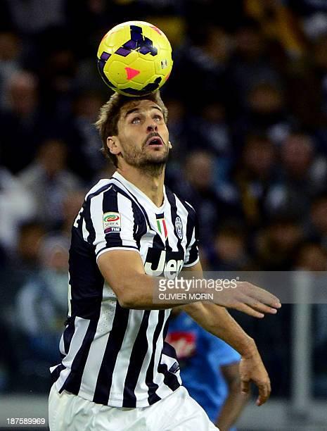 Juventus' Spanish foward Fernando Torres Llorente heads the ball during the Italian Serie A football match Juventus vs Naples on November 10 in Alps...