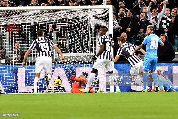 Juventus' Spanish foward Fernando Torres Llorente kicks and scores during the Italian Serie A match between Juventus and Napoli at the Juventus...