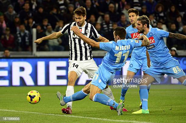 Juventus' Spanish foward Fernando Torres Llorente scores the first goal of the Italian Serie A football match Juventus vs Naples on November 10 in...