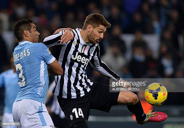 Juventus' Spanish foward Fernando Torres Llorente vies for the ball with Lazio's Argentinian defender Andre Dias Goncalves during the Italian Serie A...