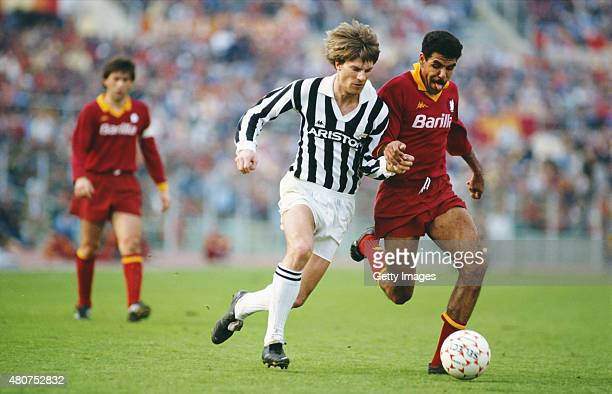 Juventus striker Michael Laudrup tussles with AS Roma defender Toninho Cerezo during a Serie A match between AS Roma and Juventus at the Olympic...