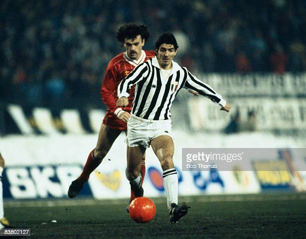 Juventus striker Paolo Rossi is chased by Liverpool's John Wark during the UEFA Super Cup Final at the Stadio Comunale in Turin 16th January 1985...