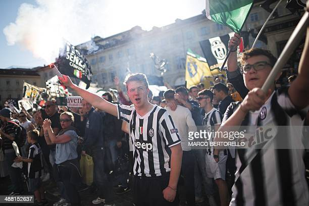 Juventus supporters celebrate after their football club won the Italian Scudetto championship, in Piazza San Carlo in Turin, on May 4, 2014. Juventus...
