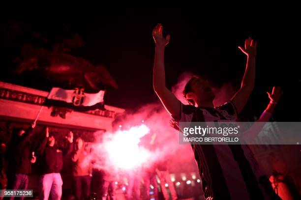 Juventus' supporters celebrate in central Turin after their team won a seventh straight Serie A title scudetto after a goalless draw against tenman...