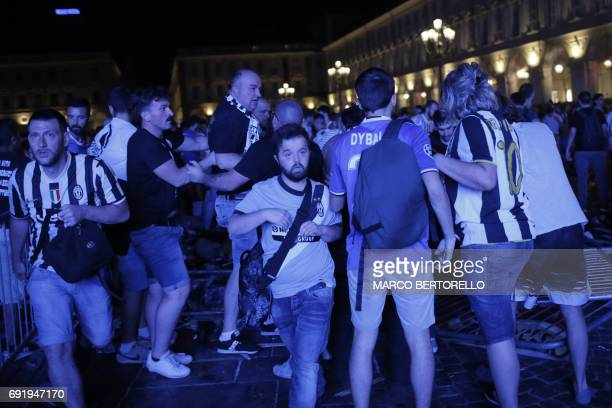 Juventus' supporters evacuate Piazza San Carlo after a panic movement in the fanzone where thousands of Juventus fans were watching the UEFA...