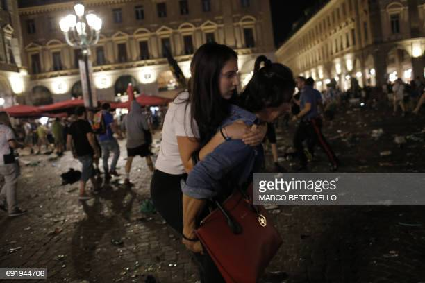 Juventus' supporters evacuate the Piazza San Carlo after a panic movement in the fanzone where thousands of Juventus fans watched the UEFA Champions...