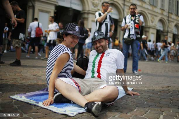 Juventus' supporters gather to follow the UEFA Champions League Final football match between Juventus and Real Madrid on June 3, 2017 in Piazza San...