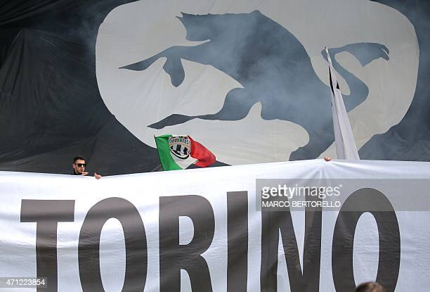 Juventus' supporters hold a banner before the Italian Serie A football match Torino vs Juventus on April 26 2015 at the 'Olympic Stadium' in Turin...