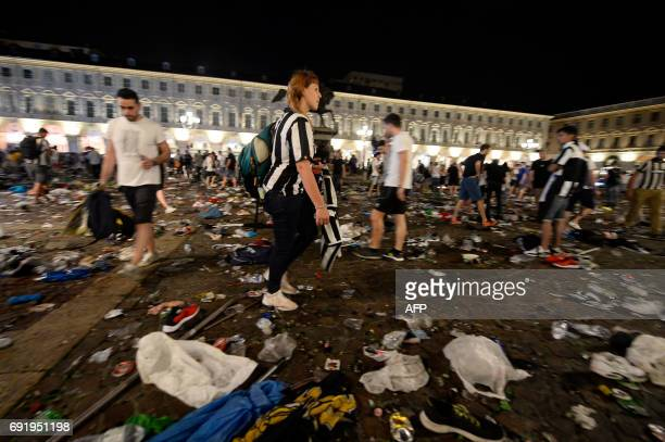 Juventus supporters look for personal belongings at Piazza San Carlo after a panic movement in the fanzone where thousands of Juventus fans were...