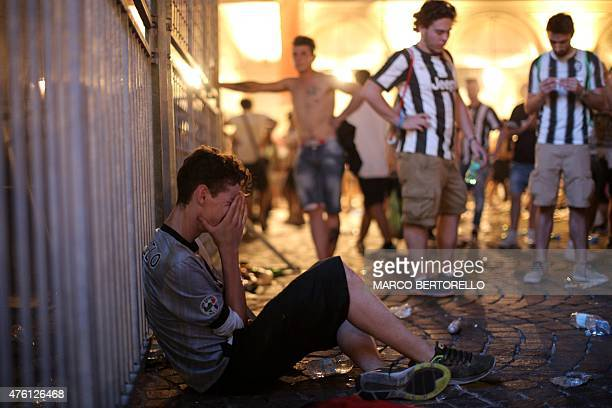 Juventus' supporters react after the defeat of the Juventus Team during the UEFA Champions League Final football match between Juventus and FC...