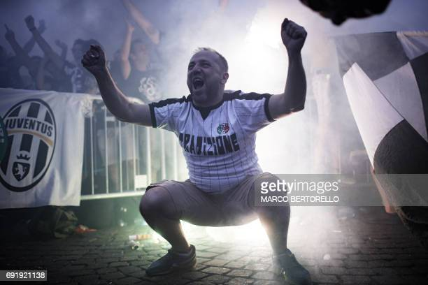 TOPSHOT Juventus' supporters react as they follow the UEFA Champions League Final football match between Juventus and Real Madrid on a giant screen...