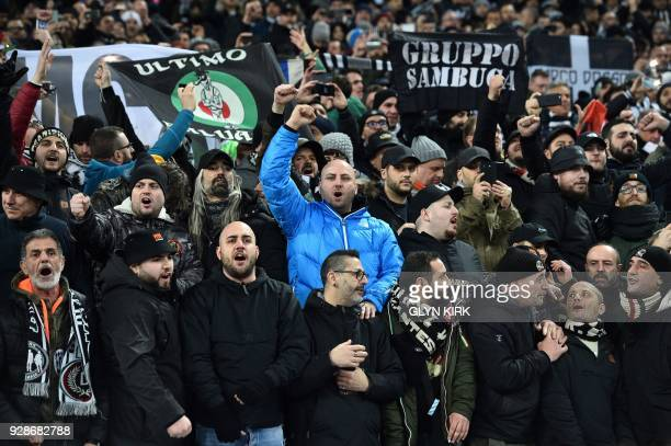 Juventus supporters shout in the crowd during the UEFA Champions League round of sixteen second leg football match between Tottenham Hotspur and...