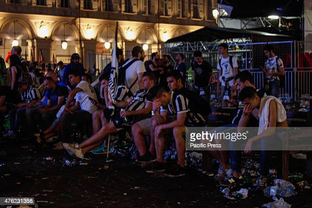 Juventus supporters show their sadness as they leave at the end of the Champions League final soccer match between Juventus and Barcelona in Turin's...