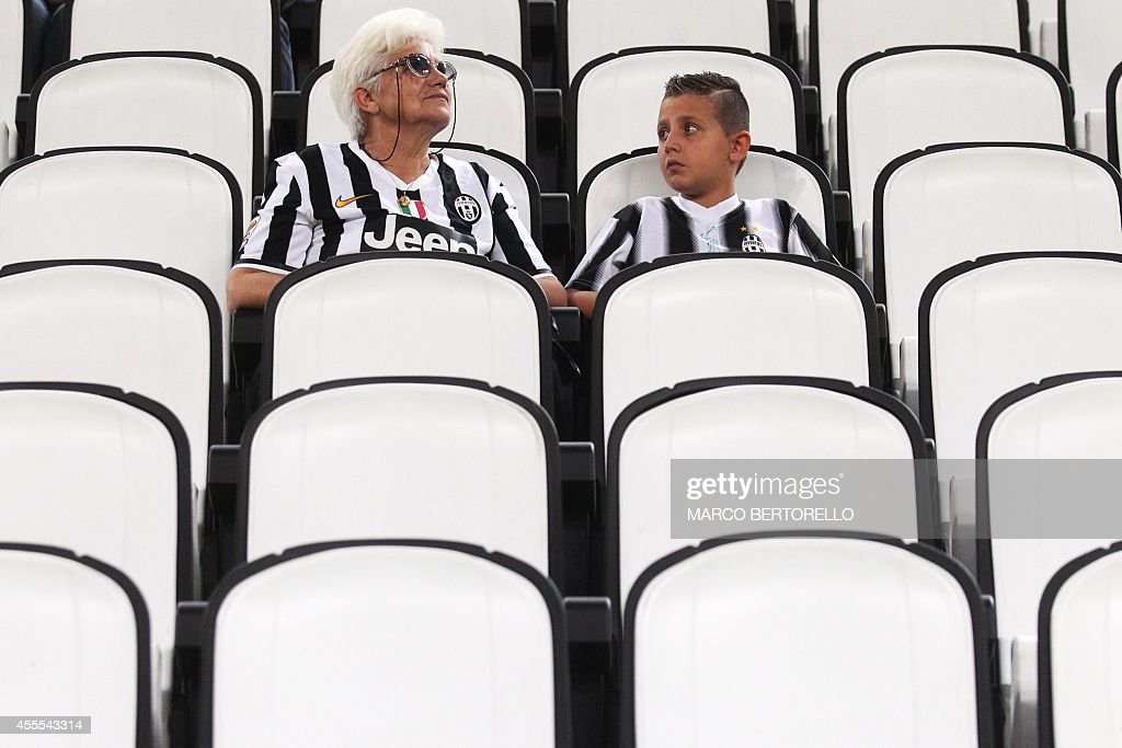 Juventus supporters wait for the start of the UEFA Champions League football match Juventus vs Malmo at 'Juventus Stadium' in Turin on September 16, 2014.