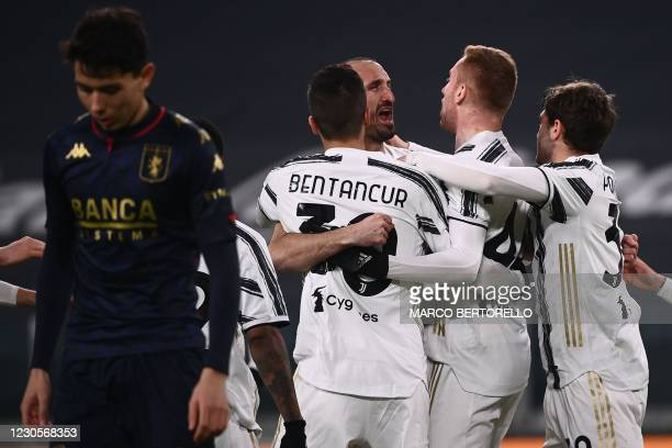 Juventus' Swedish forward Dejan Kulusevski celebrates with Juventus' Uruguayan midfielder Rodrigo Bentancur and Juventus' Italian defender Giorgio...