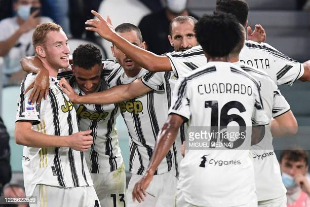 Juventus' Swedish forward Dejan Kulusevski celebrates with teammates after opening the scoring during the Italian Serie A football match Juventus vs...