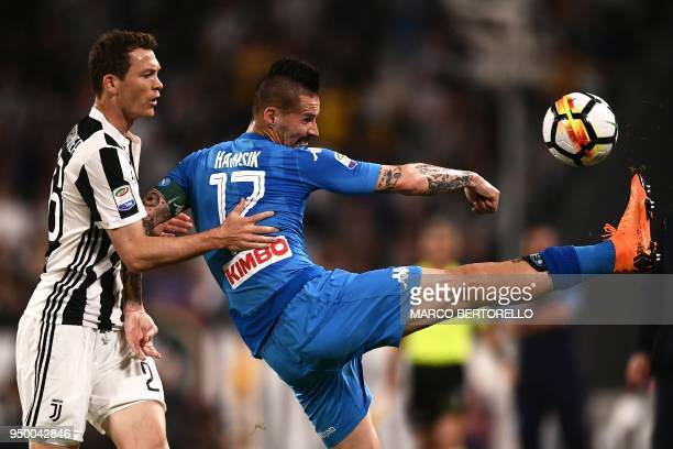 Juventus' Swiss defender Stephan Lichtsteiner fights for the ball with Napoli's Slovakian midfielder Marek Hamsik during the Italian Serie A football...