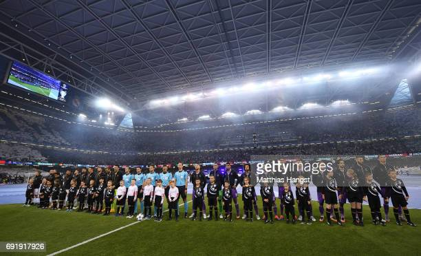 Juventus team and Real Madrid team line up rior to the UEFA Champions League Final between Juventus and Real Madrid at National Stadium of Wales on...