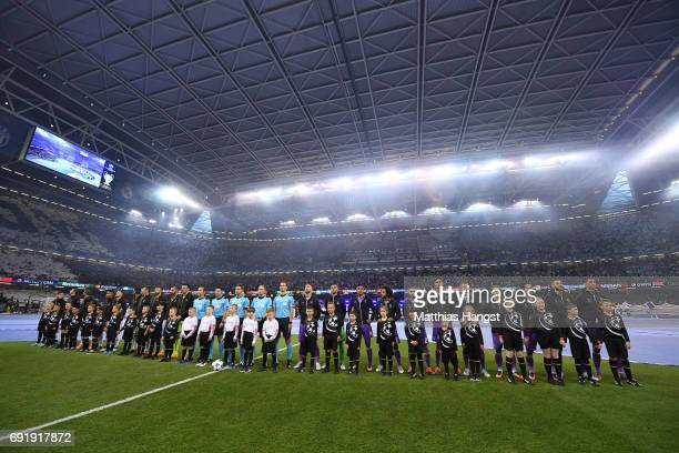 Juventus team and Real Madrid teams line up rior to the UEFA Champions League Final between Juventus and Real Madrid at National Stadium of Wales on...