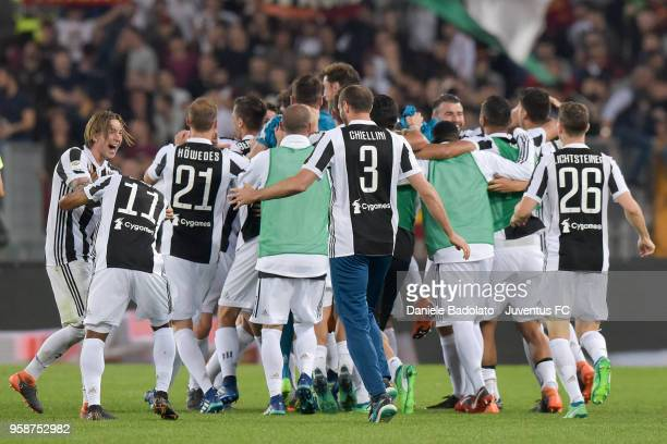 Juventus team celebrate during the serie A match between AS Roma and Juventus at Stadio Olimpico on May 13 2018 in Rome Italy