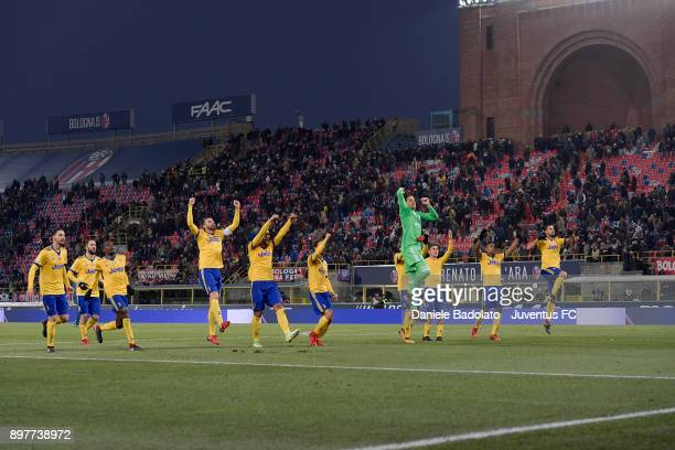 Juventus team celebrate during the Serie A match between Bologna FC and Juventus at Stadio Renato Dall'Ara on December 17 2017 in Bologna Italy