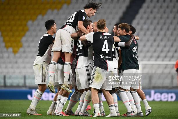 Juventus' team celebrates the Serie A title after the Italian Serie A football match between Juventus and Sampdoria played behind closed doors at the...