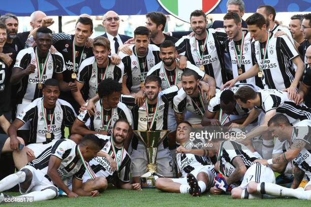 Juventus team celebrates victory holding Serie A cup after the Serie A football match n37 JUVENTUS CROTONE on at the Juventus Stadium in Turin Italy