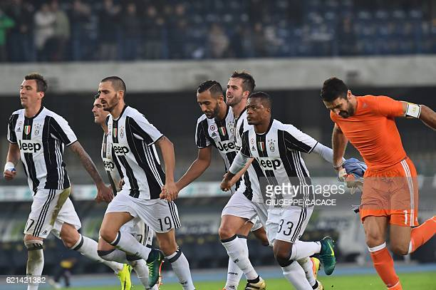 Juventus' team players celebrate at the end of the Italian Serie A football match Chievo Verona vs Juventus at Bentegodi Stadium in Verona on...