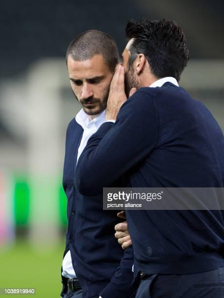 Juventus Turin's Gianluigi Buffon und Leonardo Bonucci talk to each other as they walk across the pitch of the BorussiaPark soccer stadium in...