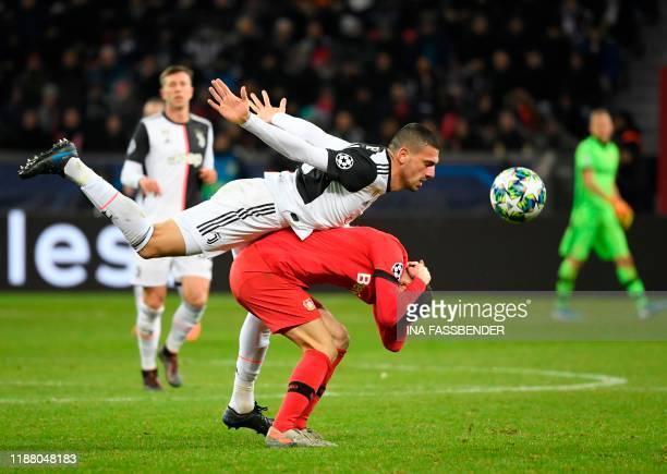 TOPSHOT Juventus' Turkish defender Merih Demiral and Leverkusen's German midfielder Kai Havertz vie for the ball during the UEFA Champions League...