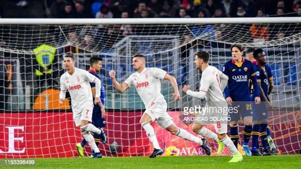 Juventus' Turkish defender Merih Demiral celebrates after opening the scoring during the Italian Serie A football match AS Roma vs Juventus on...