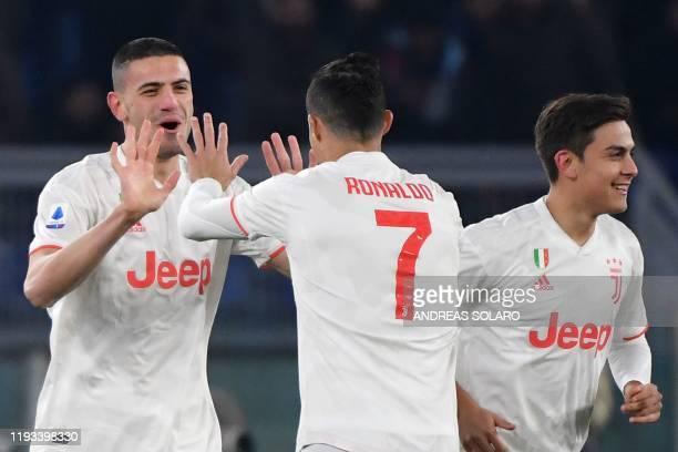 Juventus' Turkish defender Merih Demiral celebrates with Juventus' Portuguese forward Cristiano Ronaldo and Juventus' Argentine forward Paulo Dybala...