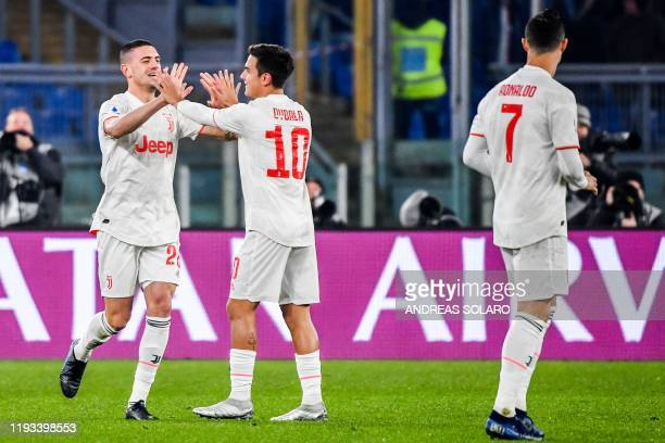 Juventus' Turkish defender Merih Demiral celebrates with Juventus' Argentine forward Paulo Dybala after opening the scoring during the Italian Serie...