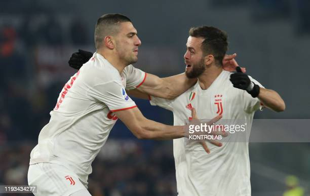 Juventus' Turkish defender Merih Demiral celebrates with teammate Juventus' midfielder from Bosnia and Herzegovina Miralem Pjanic after scoring a...