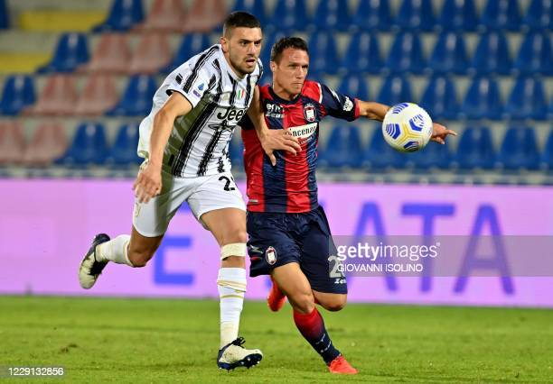 Juventus Turkish defender Merih Demiral fights for the ball with Crotone's Italian forward Luca Siligardi during the Italian Serie A football match...
