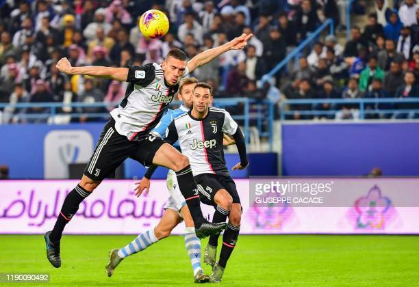 Juventus' Turkish defender Merih Demiral heads the ball during the Supercoppa Italiana final football match between Juventus and Lazio at the King...