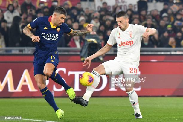 Juventus' Turkish defender Merih Demiral shoots to open the scoring despite AS Roma's Serbian defender Aleksandar Kolarov during the Italian Serie A...