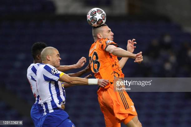 Juventus' Turkish defender Merih Demiral vies with Porto's Portuguese defender Pepe during the UEFA Champions League round of 16 - 1st leg match...