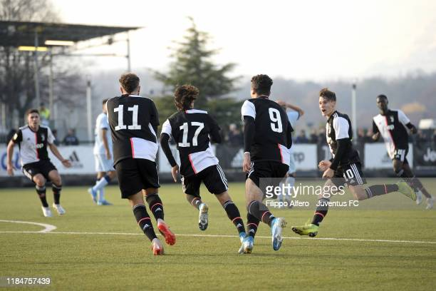 Juventus Under 19 players celebrate after scoring a goal during the UEFA Youth League match between Juventus U19 and Atletico Madrid U19 on November...