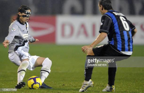 Juventus Urugayan defender Martin Caceres fights for the ball with Atalanta 's defender Gianpaolo Bellini during their Italian Serie A football match...